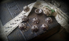 10 stuks tibetaans zilveren kralenkapjes 8 x 4 mm
