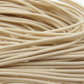 3 meter gekleurd elastiek draad van rubber voorzien van een laagje stof  0,8mm créme naturel