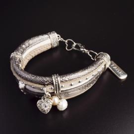 Prachtige armband, verstelbaar met metalen elementen w.o. bedel faith