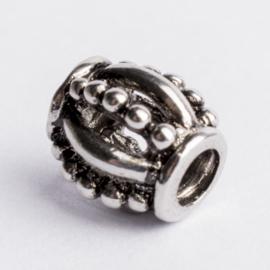 Be Charmed kraal zilver met een rhodium laag (nikkelvrij) c.a.11x 7mm groot gat: 4mm