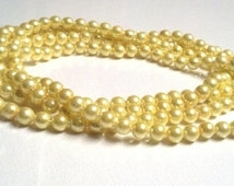 100 stuks acryl parels 4mm zacht geel