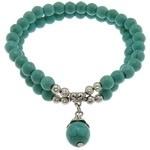 Prachtige armband met Turquoise 6mm, 10mm, 4mm en Tibetaans zilver en elastiek