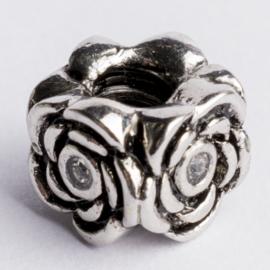Be Charmed kraal zilver met een rhodium laag (nikkelvrij) c.a.10.5x 8.5mm groot gat: 4mm