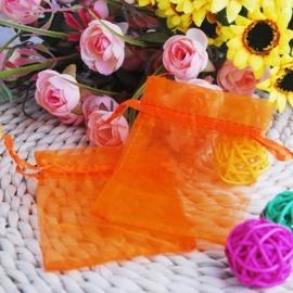 c.a. 100 oranje organza zakjes 10 x 15 cm
