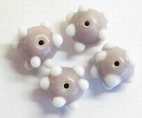 Per stuk Glaskraal India oud-roze met witte pukkels 8 mm