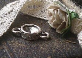 Per stuk metalen zilveren tussenzetsel bewerkt zonder steen 15 x 8 mm