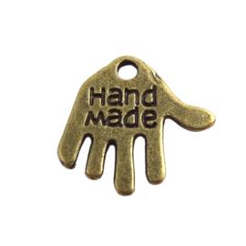 """10 stuks tibetaans zilveren hand met """"Hand made"""" erop, geel koper c.a. 12 x 10 x 1mm gat: 1mm"""