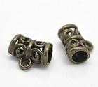 Tibetaans zilveren tonnetje bails 11,5 x 9 x 5,5mm oogje: 2mm geel koper kleur