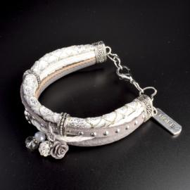 Prachtige armband, verstelbaar met metalen elementen w.o. bedel hoop