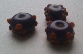 10 x glaskraal India rondel transparant paars/oranje bruin met opliggende bloemmotief 13 x 8 mm