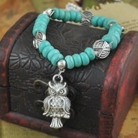 Prachtige Turquoise armband met elastiek + uil bedel