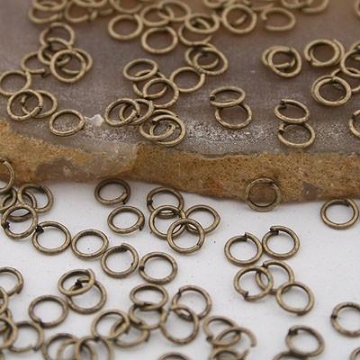100 geel koperen ringetjes 5mm 0,7mm dik