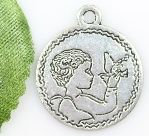 2 x  Tibetaans zilveren muntje 19 x1,5 mm gat 2mm