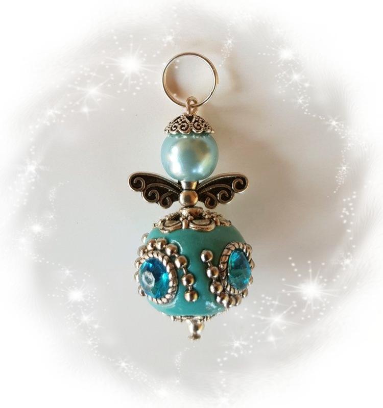 Per stuk engel gemaakt van een blauwe Kashmirikraal van 20mm(bestelllenM)