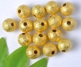 10 stuks Stardust kralen goudkleur 8mm