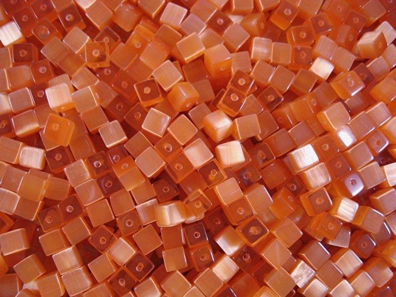 20 stuks Glaskraal kubus cate-eye 4mm oranje