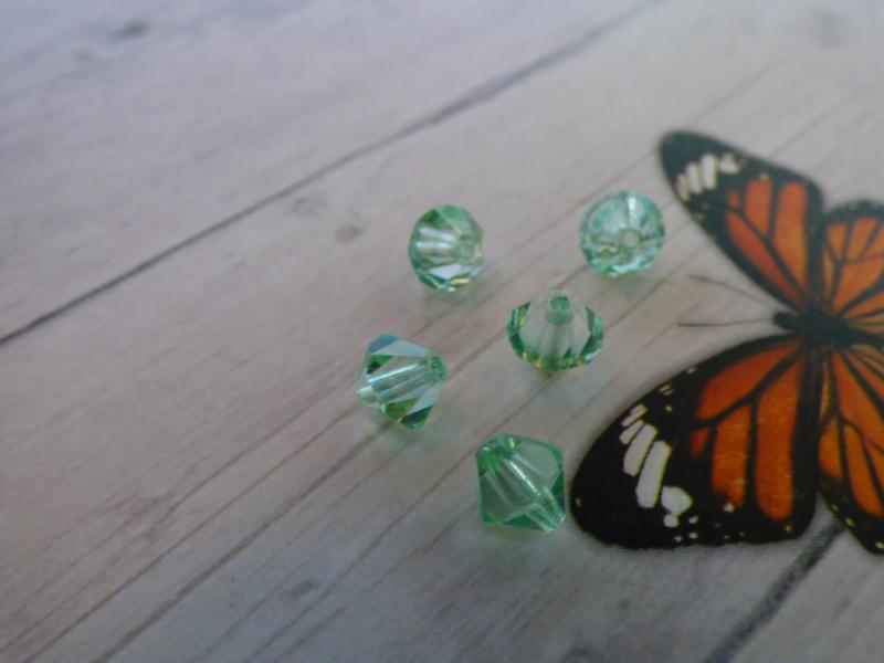 10x Preciosa Kristal Bicone ca. 6mm  gat: 1mm
