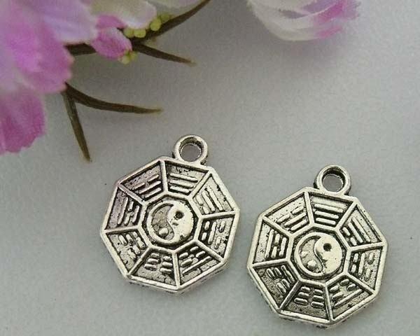 10 stuks tibetaans zilveren muntje 13 x 1,5mm gat: 2mm