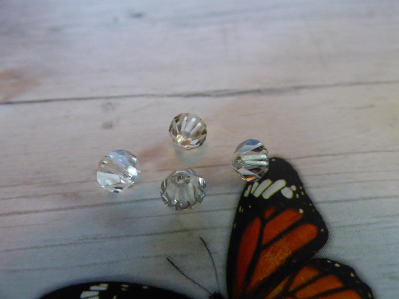 10 x Preciosa Kristal Bicone afmeting ca. 6mm oogje:1.1mm