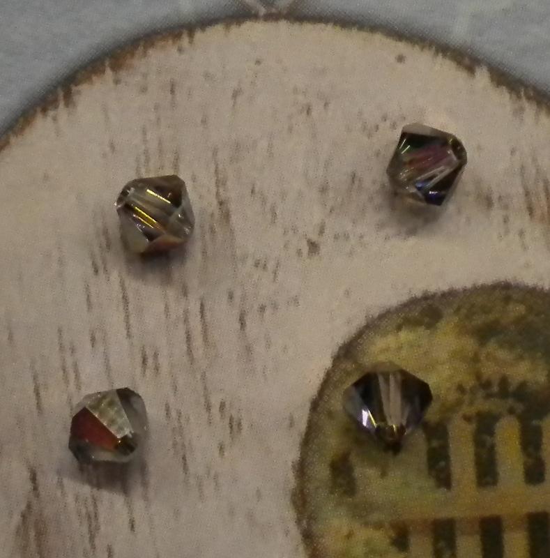 20x Swarovski kristal bicone Grijs AB 4mm gat: 1mm