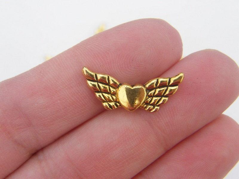 10 x Tibetaans zilveren Engelen kraal 9 x 22 x 3mm gat: 1mm goudkleur