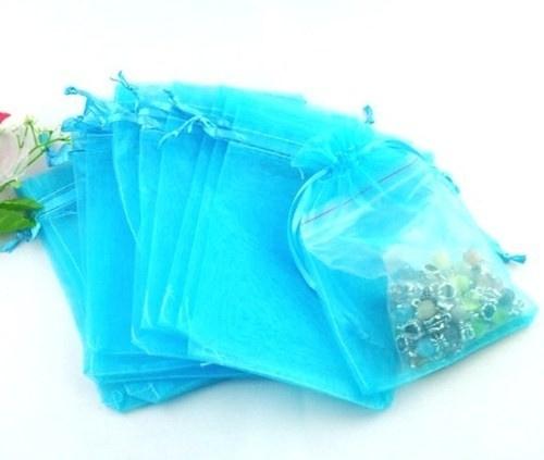 c.a. 50 stuks organza zakjes 7x9cm turquoise