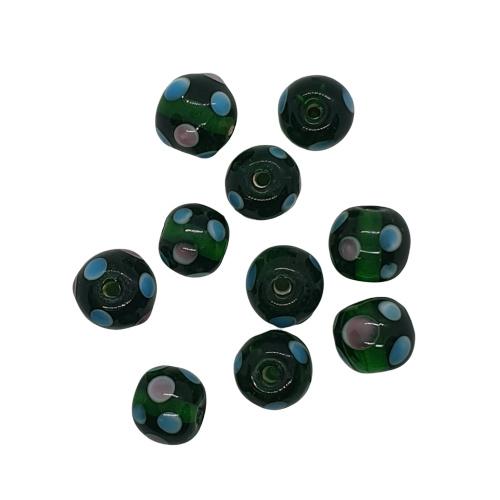 10 x glaskraal goen met stippen handgemaakt c.a. 11,5 x 13mm gat: c.a. 2,4mm
