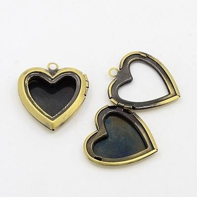 Prachtige geel koper kleur medaillon hartvorm 23 x 25 x 6mm gat: 2mm zonder glaasje