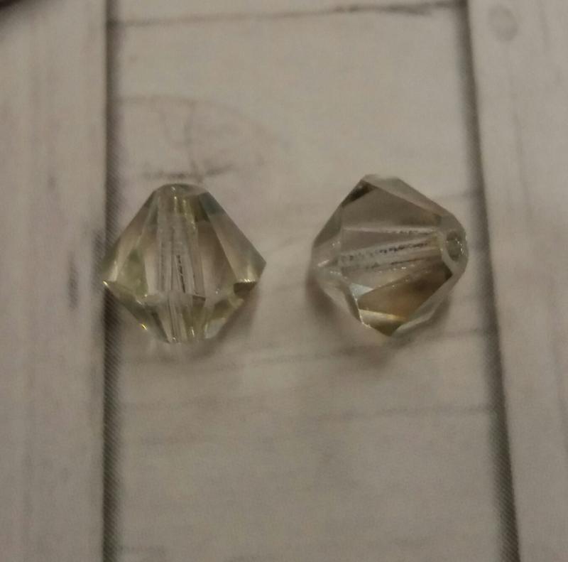 20x preciosa kristal bicone transparant heel licht groene glans 5,5/6 mm Gat: 1 mm