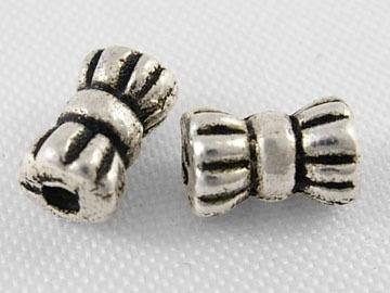 20 stuks tibetaans zilveren kraaltjes 4 x 6mm gat: 1mm