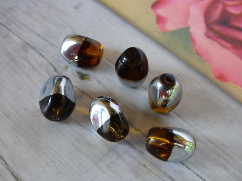 1x Duo kleur Kraal Zilver/bruin ca. 13x 8.5mm Oogje: 1.7mm