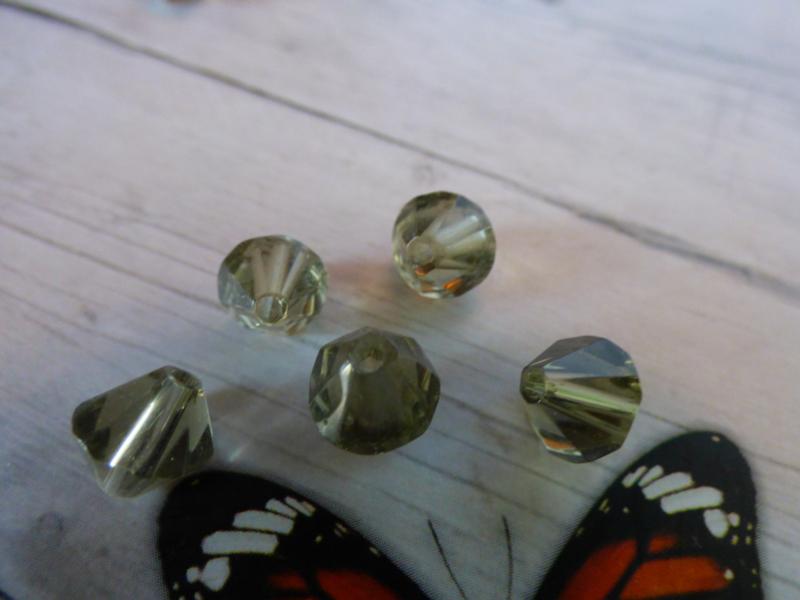 10x Preciosa Kristal Bicone afmeting ca. 8mm oogje:1.5mm
