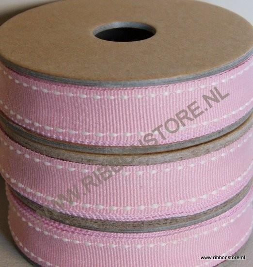 Pink with cream stitches