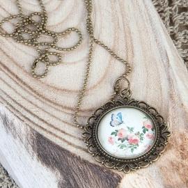 vintage met bloemen en vlinder hanger