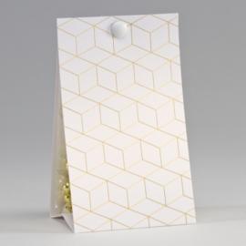 Snoepzakwikkel met geometrisch patroon in goudfolie