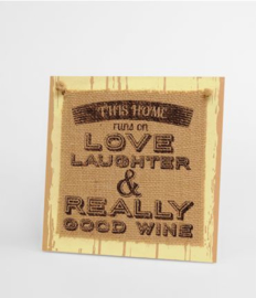 Wooden sign This home runs on love |