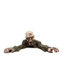 Zombie uit de grond kruipend