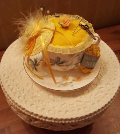 Yellow teacup pinkushion springtime