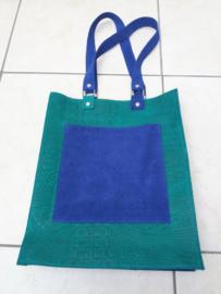 Shopper van felgroen en blauw leer