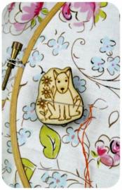 Naaldenhouder Hond
