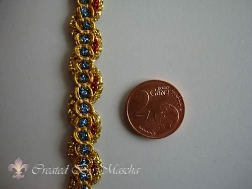 Decoratief lint, goud met blauw en rood,  10 mm nr 52223-1
