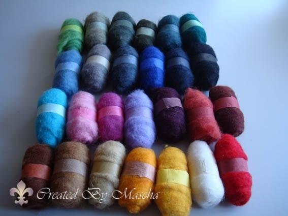 Gekaarde wol, kleuren assortiment.