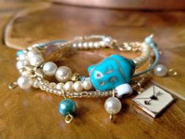 3 delig turquoise/goud/roomwit armbandje in buddha style