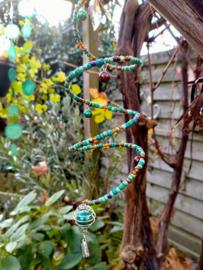 Turquoise en bruine Windspinner