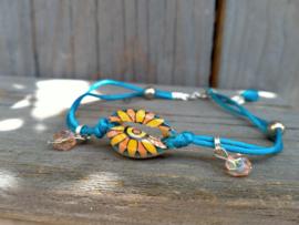 Enkelbandje blauw/oranje kauri schelpje