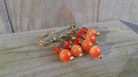 Bronskleurige dasspeld met oranje cat eye glaskralen