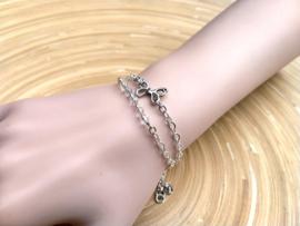 Set van 2 zilverkleurige RVS armbandjes met vlinder en glaskraaltjes