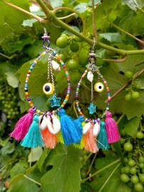 Oorbellen Ibiza style met kauri schelpjes en evel eye kralen