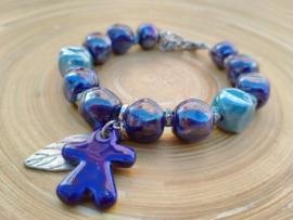 Blauwe armband van keramiek met strass rondellen