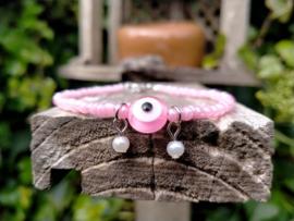 Enkelbandje met roze evel eye kraal